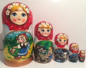 Matryoshka doll with the tale «Little Red Riding Hood»