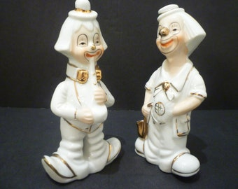 CLOWN FIGURINES.  Vintage Clown Ornaments, Collectible Clown Figurines. A Set Of Two White And Gold 1960's Collectible Clown Figurines.