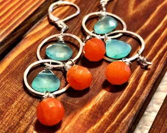 Beautiful sunset inspired aqua and orange chalcedony dangle from handforged, hammered, sterling silver hoops.