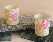 Delicate lacy pinks, lavenders and golds offer a glow reminscent of alabaster from these hand marbled silk votives from Brooklyn Marbling