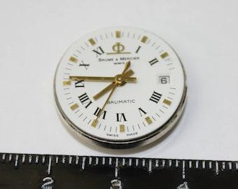 Baume & Mercier Geneve Baumatic mechanism , Date . Authentic crystal , crown .