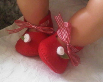 Red an white baby felt shoes