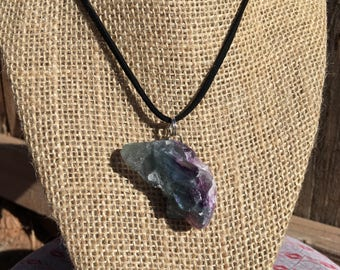 Raw fluorite on a leather cord necklace