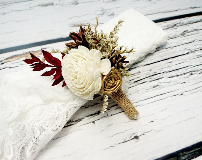 Ivory, brown, gold and burgundy rustic wedding boutonniere with pine cones
