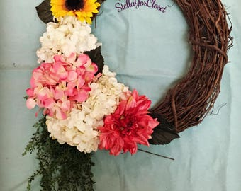 18 Inch Grapevine Wreath W/ A Variety of Silk Florals Including Hanging Greens Off to the Side