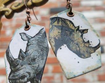 Dualin' Rhinos - hand-painted rhinoceros charm earrings - copper