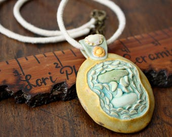 Hand sculpted ceramic pendant