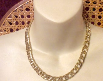 Gold toned metal flat curb chain collar choker necklace.