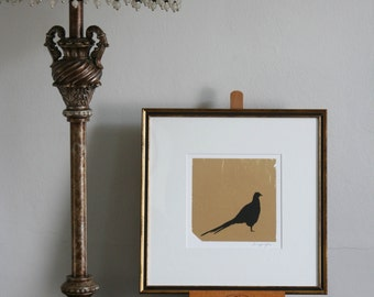 Hand drawn pheasant silhouette in pen and ink on gold leaf