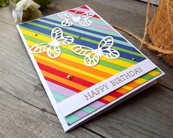 Bright rainbow coloured birthday card with butterflies and heat embossed sentiment