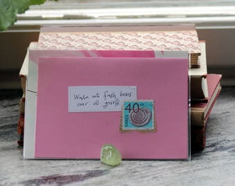 Waste not fresh tears over old griefs Pink card with handwritten quote and Swedish fossile postal stamp