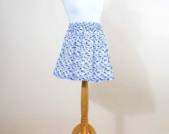 SKIRT with blue fish and waves