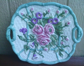 A Platter with Handles and a Floral design, OMNIBUS.
