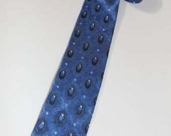 vintage 50's - 60's Narrow neck tie. Funky jacquard woven design - Starburst with Silver glitter dots. Square ends.