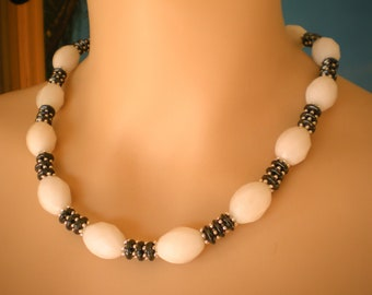 Wonderful Necklace, made with white Barrel Jade and Hematite Rondell Beads, silver colored Lobster Clasp