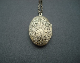antique brass locket necklace, vintage two sided victorian style floral pattern oval locket necklace