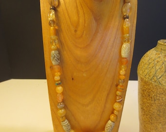 Honey and gold necklace with carved jade beads