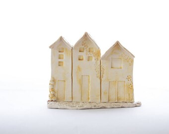 Front of 3 houses ceramic yellow mustard and light brown
