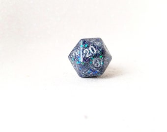 Individually cast clear resin D20 dice ring with pewter grey glitter