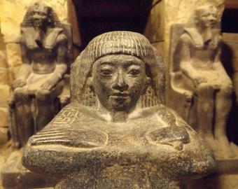 Egyptian block statue - museum replica sculpture. Reign of Horemheb
