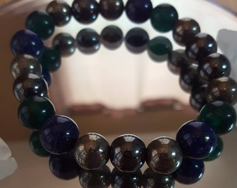 Increase Braclet, made with pyrite, hematite, lapis, and green jade.