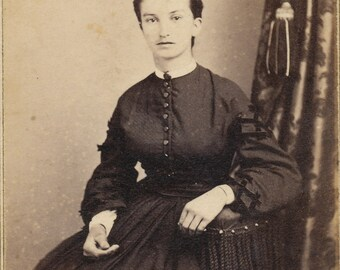 CDV of a well dressed woman in mourning dress / carte de visite.