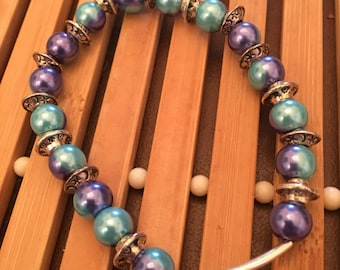 7.5 inch silver and blue and purple beaded stretch bracelet.