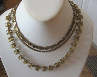 Vintage goldtone chain choker/necklaces, 3 necklaces, 2 chains and 1 necklace with large amber stones