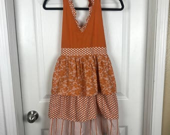 Orange patterned apron