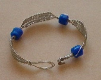 Wire weave bracelet with blue African trade beads, silver color, handmade in Hilo, Hawaii