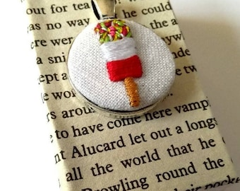 Hand embroidered fab ice lolly. Wearable textile jewellery, set into silver toned pendant. Repurposed linen fabric, ideal summery gift.