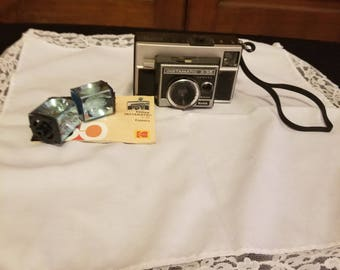 Instamatic x-35 Camera with flash cubes and manual