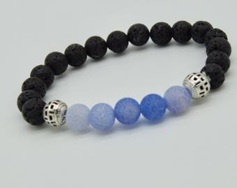 Blessed by Buddhist Monk. Handmade Tanzanite and  Lava Stone bracelet