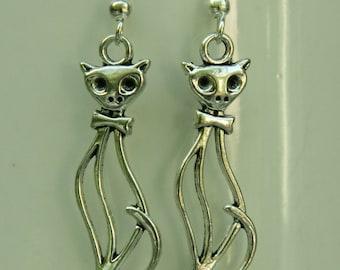 Cat Jewelry: Silhouette cat earrings with bow tie. Elegant earrings. Long earrings.
