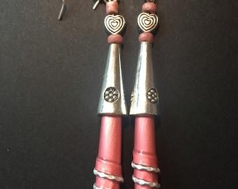 Spiral pink earrings.