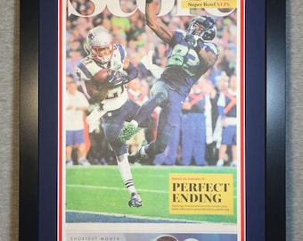 New England Patriots - 2015 Super Bowl XLIX Champions - Boston Globe Newspaper - Double Matted & Framed (Official Team Colors)