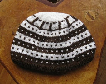 Norwegian Fana Pattern Cap knit in Brown and White worsted weight acrylic yarn.