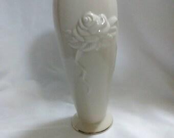 Vintage. White round trimmed in gold Lenox vase. Rose design impression.