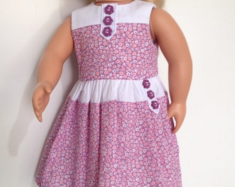 Day dress in mauve flowers with button tabs feature for 18in dolls like American Girl and Our Generation.