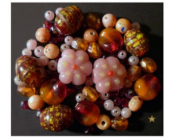 Orange Indian and Czech beads, pink, red, glass beads of various shapes