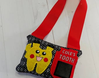 Pokemon themed Tooth fairy pocket pillow with yellow tooth shaped Pokemon