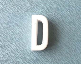 miniature. decor. minimalist. monogram. capital letter. D. marquee letter. vintage. letter. white. uppercase. name. initial. decoration