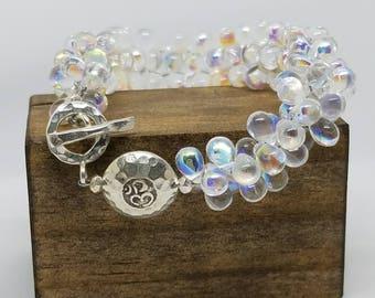 Iridescent Teardrop Lei With Om Silver Bead Yoga Bracelet