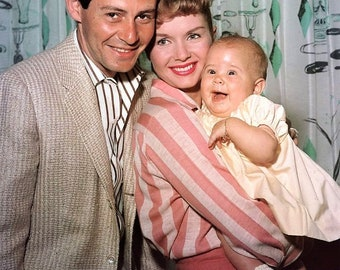 Eddie Fisher and Debbie Reynolds with daughter Carrie in 1957.