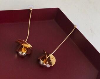 gold art style earrings