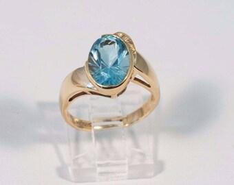 4.6 Gram 14K Yellow Gold Blue Stone Ring , size 6.5
