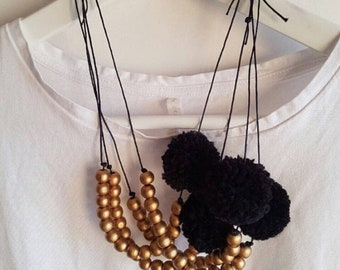 Helena necklace with pompoms and gold wood beads