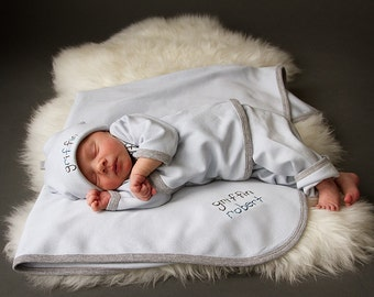 hand-embroidered welcome home outfit for baby.