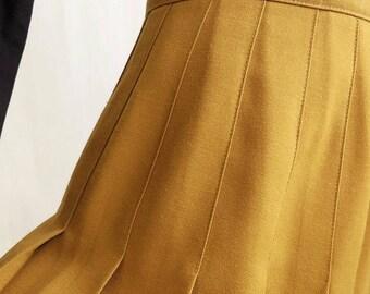 pleated midi skirt. size small medium.
