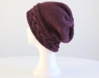 Purple hand knit slouchy hat with big cable